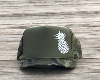 Pineapple unisex green camouflage foam trucker hat.