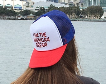 I Am The American Dream Red White And Blue Trucker Hat With Red Glitter Font, Patriotic RWB Trucker Hats, 4th OF July RWB Trucker Hats