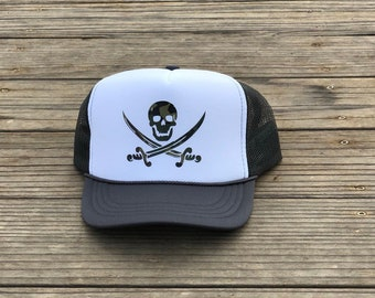 Childrens charcoal gray and white foam trucker hat with green camouflage pirate.