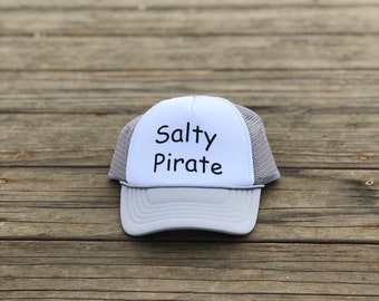Salty Pirate Infant light gray and white foam trucker hat with black font.