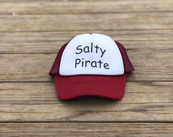 Salty Pirate Infant maroon and white foam trucker hat with black font.