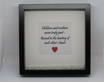 Children and mothers never truly part, bound in the beating of each others heart - in black box frame
