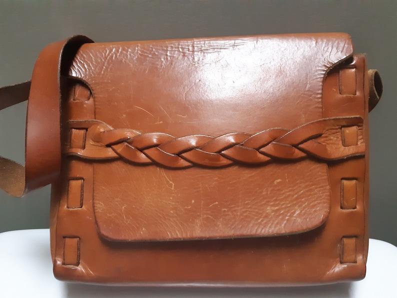 unlined Vintage handmade leather shoulder bag worn boho bag. braided detail brown thick leather scratched