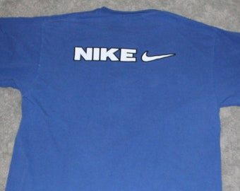 50b389cab21c Vintage 90s Clothing Nike Sportswear Brand Mens Size Large   Oversized  Womens Embroidered Retro Swoosh Spell Out Logo Short Sleeve T Shirt