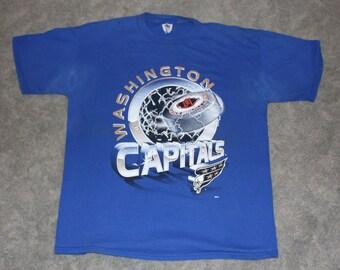 a5299c3c8 Vintage 90s Clothing NHL Washington Capitals Hockey Men Size XL   Oversized  Womens Retro Logo Spell Out Big Print Blue Short Sleeve T Shirt