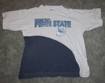 f9ab7216b5662 Vintage 90s Clothing University of Penn State Nittany Lion PSU Men Size XL  or Oversized Womens Retro Distressed Short Sleeve College T Shirt