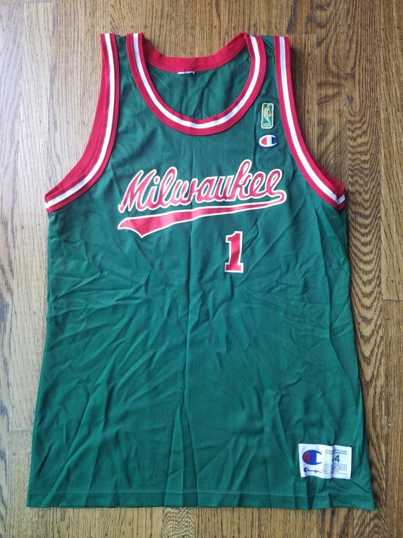 detailed pictures 992a4 64e40 Oscar Robertson Vintage Milwaukee Bucks Jersey Rare 44 Champion Gold Label  NBA