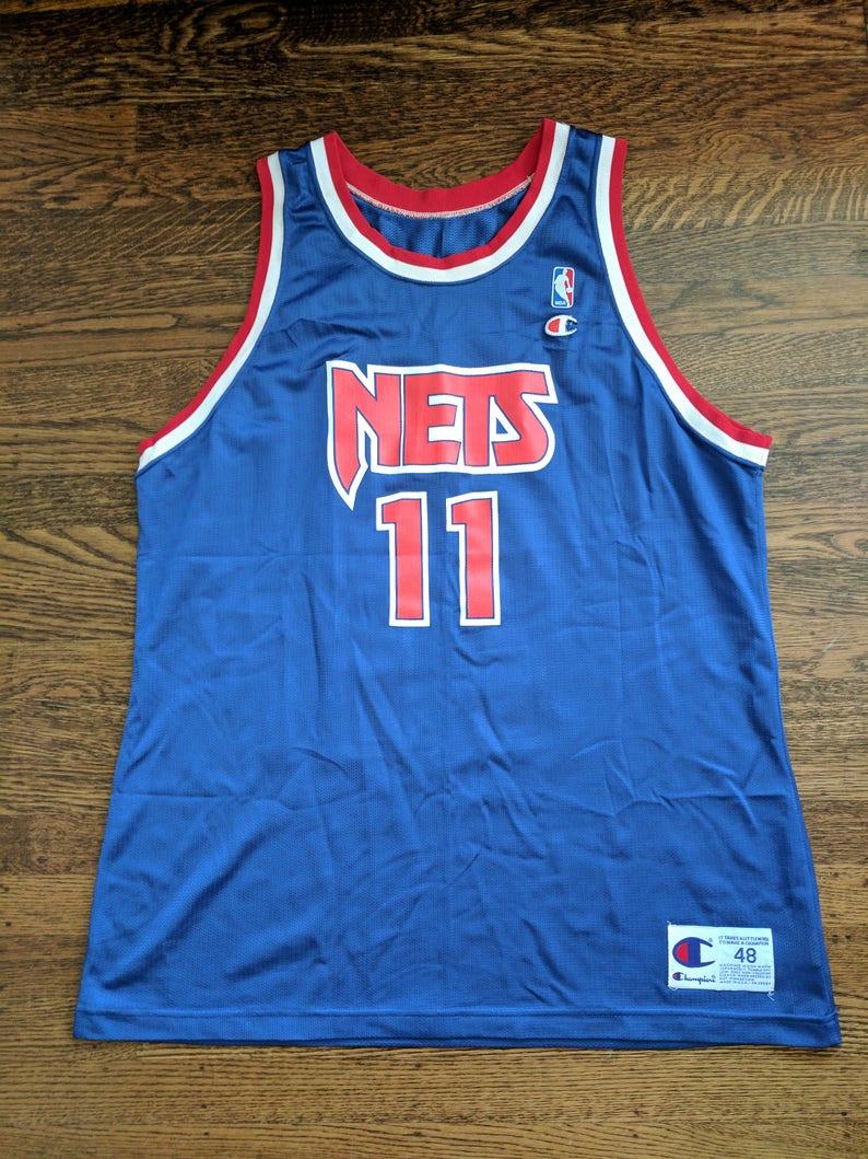 Yinka Dare Champion Jersey Rare 48 EUC NBA New Jersey Nets  0dc8735d5