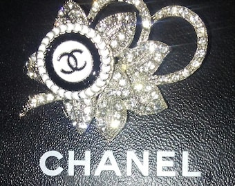 Chanel white Vintage Rhinestone Flower and Chanel button brooch