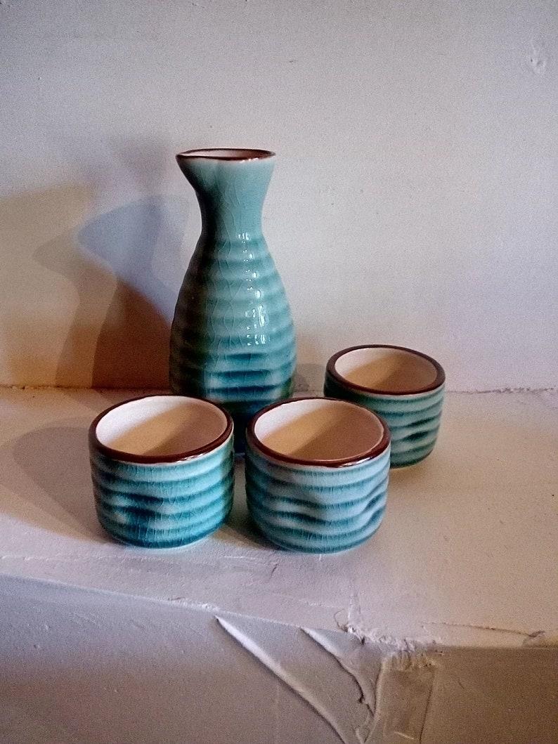 greeny blue liqueur set pretty crackle- glazed small ceramic pourer and three cups Sak\u00e9 set