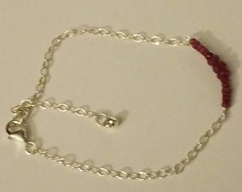"""Sterling silver bracelet with rubies. Size 7"""" wrist."""
