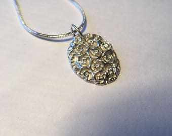 Beautiful handmade fine silver pendant