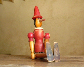 Wood handmade jointed Pinocchio doll with rubber nose | 1950s