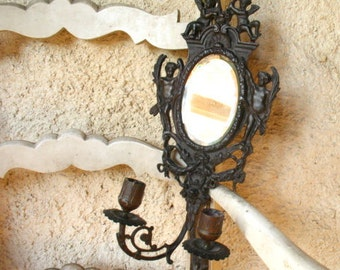 19th century wall sconce with two candle holders and an oval mirror, French, Brass.
