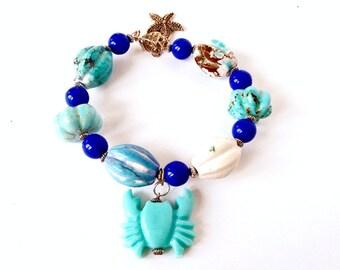 Bracciale ceramica, bracciale rigido, bracciale con ciondolo, bracciale mare, bigiotteria design, bracciale stella marina, granchio resina