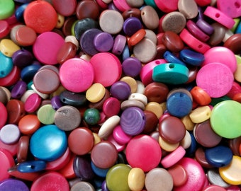 Tagua nut coin beads 9-15mm Mixed Colors, Mixed Colors vegetable ivory tagua nut 9-15mm coin beads.