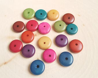 Tagua nut rondelle beads 11-12mm multi colors, vegetable ivory tagua nut 11-12mm rondelle beads.
