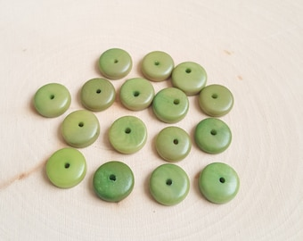 Tagua nut rondelle beads 11-12mm green, vegetable ivory tagua nut 11-12mm rondelle beads.