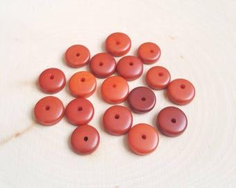 Tagua nut rondelle beads 11-12mm orange, vegetable ivory tagua nut 11-12mm rondelle beads.