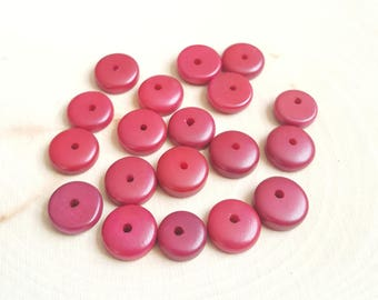 Tagua nut rondelle beads 11-12mm red, vegetable ivory tagua nut 11-12mm rondelle beads.