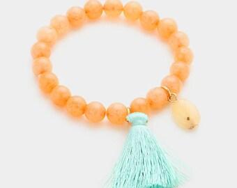 Semi precious stone bead strand stretch bracelet with tassel charm