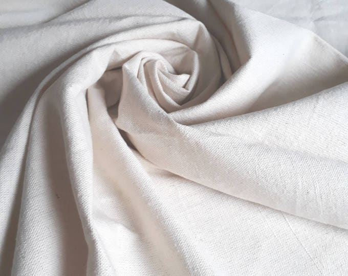 Fabric for quilting, patchwork or quilting. Thick solid cream ecru 100% cotton canvas rustic made in Egypt for lining
