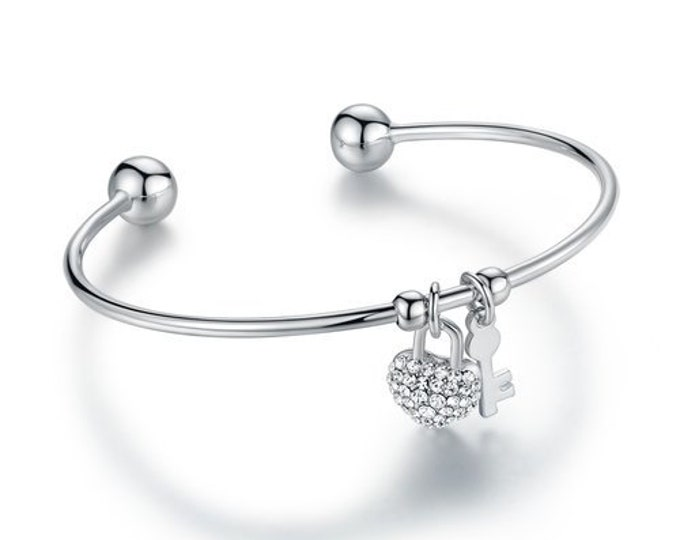 Silver Bracelet Cuff  Heart&Lock design  love symbol.Sparkling Charm bangle features a lock heart charm round-cut crystals Swarovski .