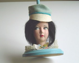 0eeb6f37e69 Flapper Doll Hat Stand Antique Art Deco Hand Painted Doll Head Turquoise  Blue Hat Stand Pretty Flapper Girl with Coy Sideways Glance 1920s