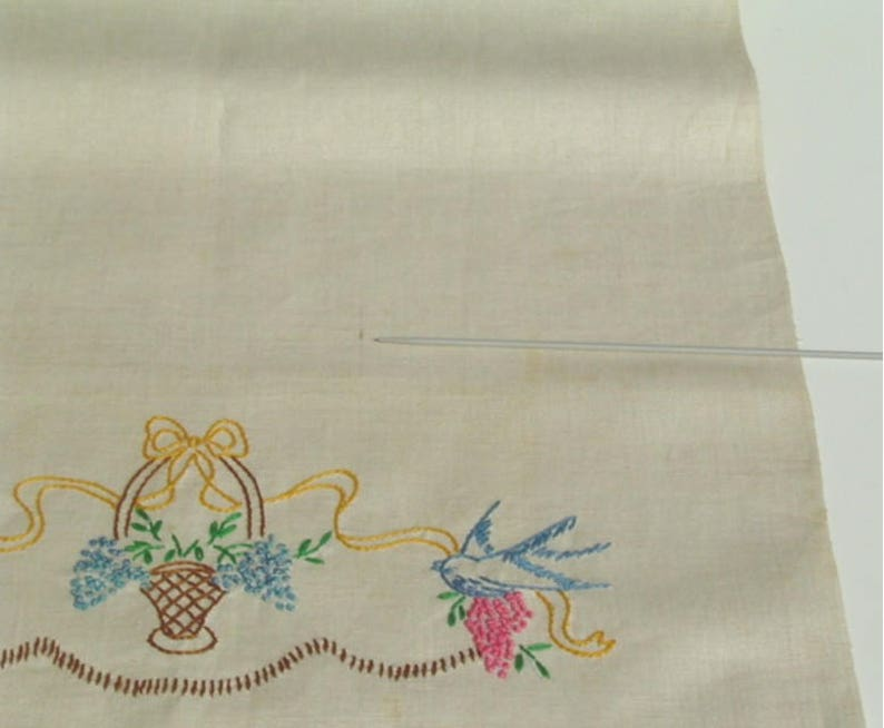 Hand embroidered blue linen bow