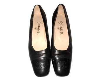 e8d208ab370f Authentic Chanel Black Leather Cap Toe Flats with Bock Heel
