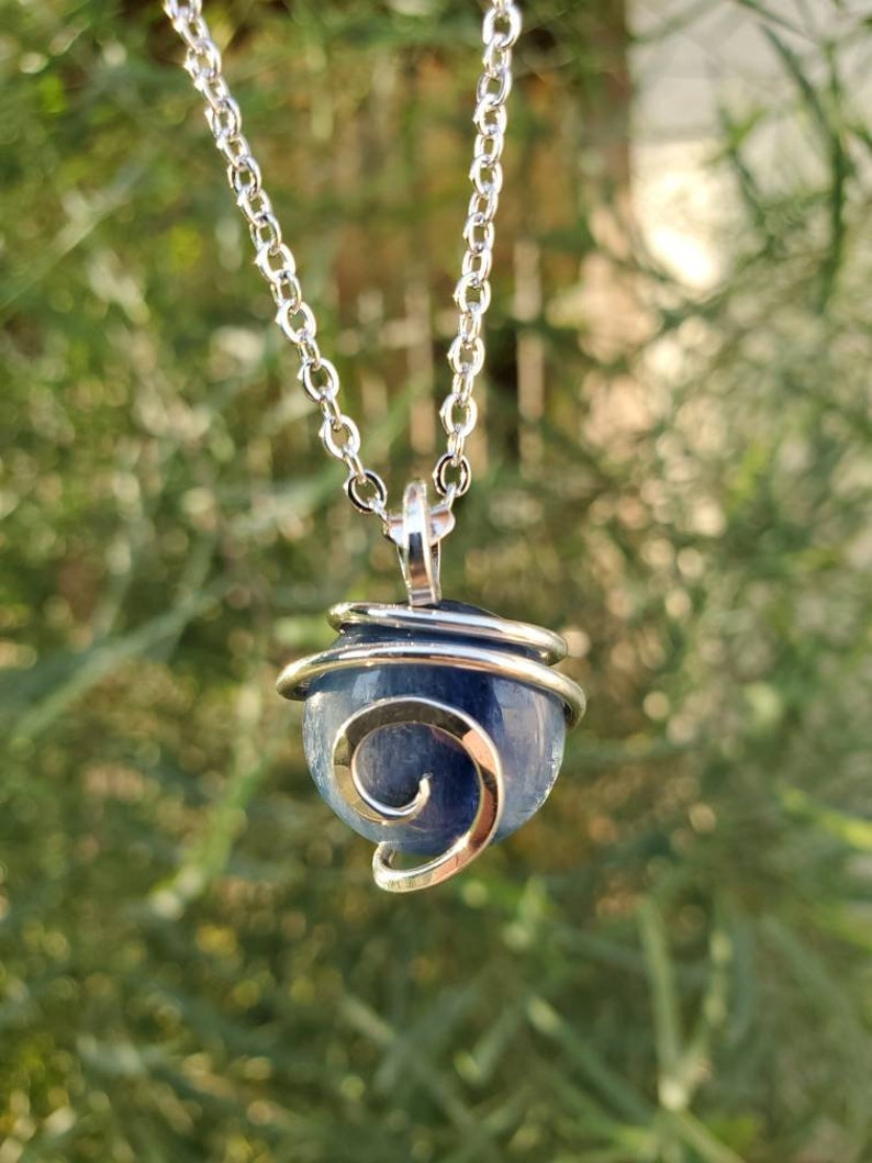 Round Kyanite in Sterling Silver tension wrap