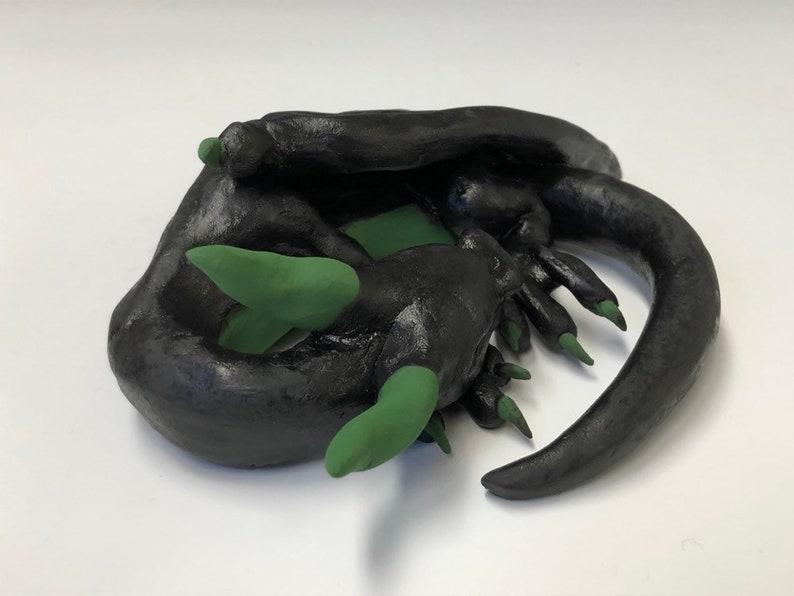 cute sleeping ceramic dragon figure M\u00e1vros