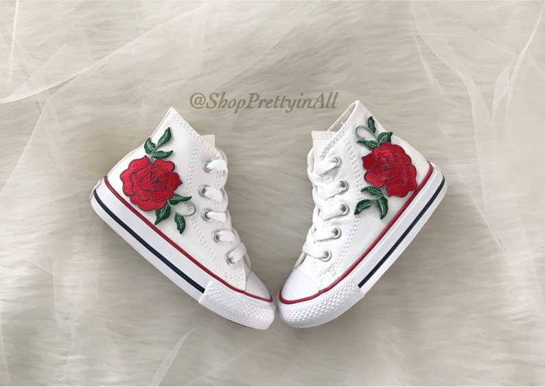 a5f39102f87a6 Kids Converse Chuck Taylor High Top Shoes Customized with Rose Appliqué