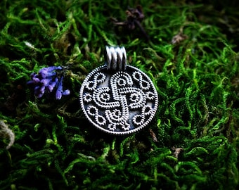 Silver bracteat pendant with solar symbol, Longobards jewelry, Anglo-Saxon jewellery, Wisigard pendant