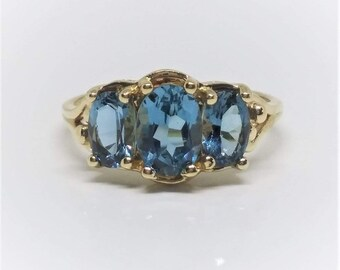 10k Yellow Gold Oval Blue Topaz Ring