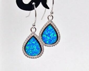 Sterling silver blue opal halo earrings