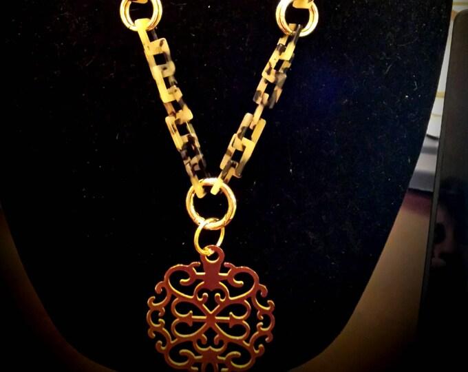 Featured listing image: Zenzii Tan Tortoise Link w/gold filigree medallion