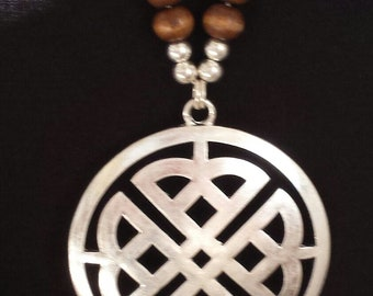 Black Cord Crystal/Wood Beads with Worn Silver Clover print Medallion