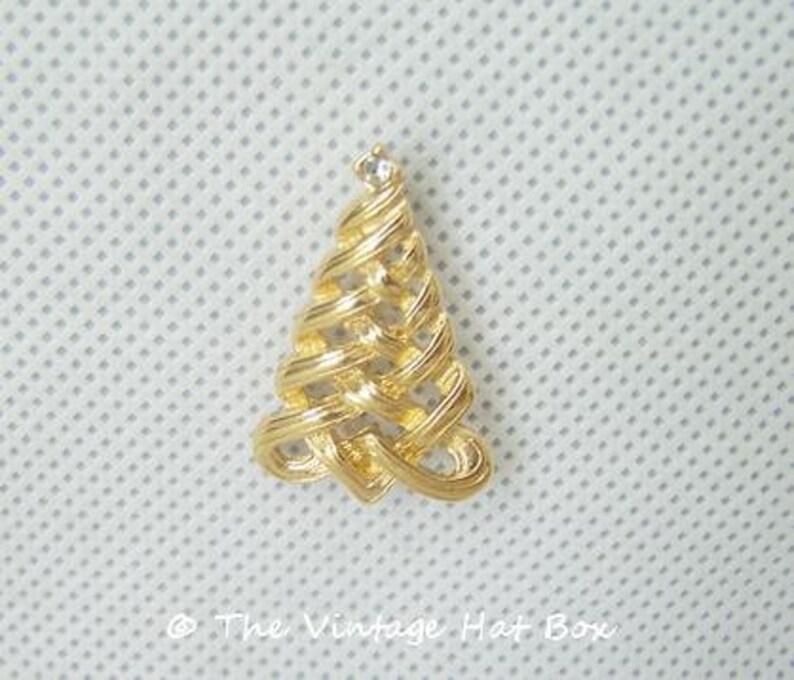 Vintage Shiny Christmas Tree Pin Topped with Rhinestone Avon image 0