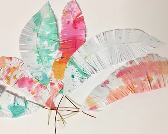 Bright coloured handmade paper feathers