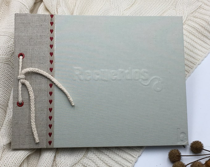 Photo album or book of handcrafted signatures of rustic-style jular (sack) fabric. Customize cover. Classic binding