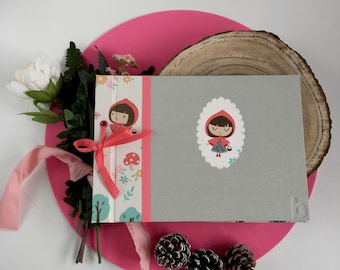 Album of souvenirs or book handmade signatures for children story of Little Red Riding Hood. To save baby growth photos