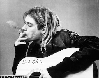 Framed Kurt Cobain Smoking  Nirvana Print 11x17 Black Slim. 100 percent of the proceeds of this item will be donated to charity