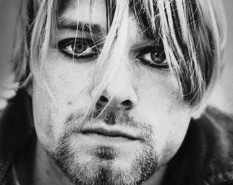 Framed Kurt Cobain Nirvana Print 11x17 Black Slim. 100 percent of the proceeds of this item will be donated to charity