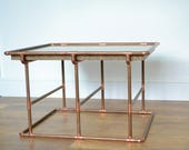 Handmade by 39 DISTINCTA 39 . Solid granite coffee side table with a copper tube base.