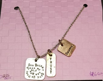 necklace Silver chain with dangle silver and bronze tags with words ORIS