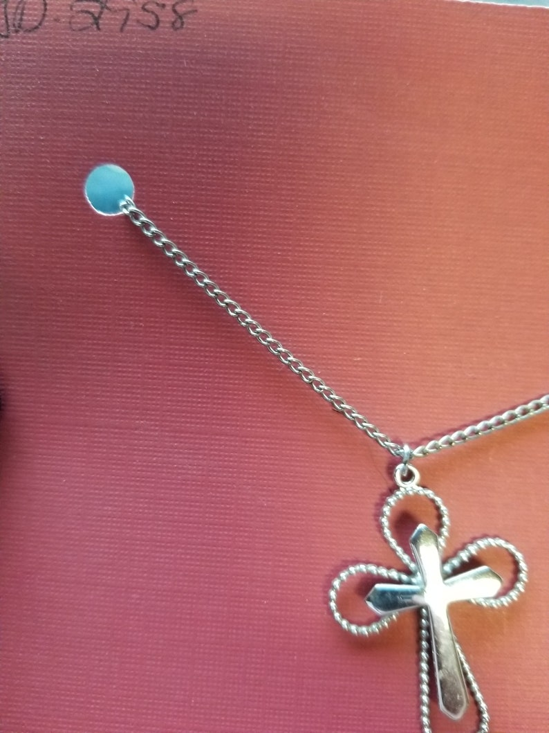 Necklace Sarah Coventry silver color curb chain holding a simple but elegant cross