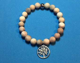 Pearl bracelet made of semi-precious beads with pendant tree of life