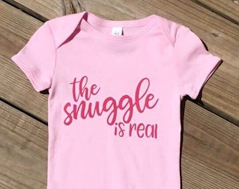 Snuggle is Real. Baby one piece. Gifts for baby. Gifts for mom. Baby Graphic Tee. Gifts for baby shower. Baby bodysuit.