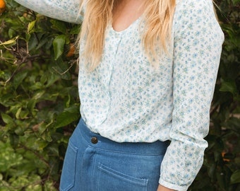 Found faded blue floral blouse